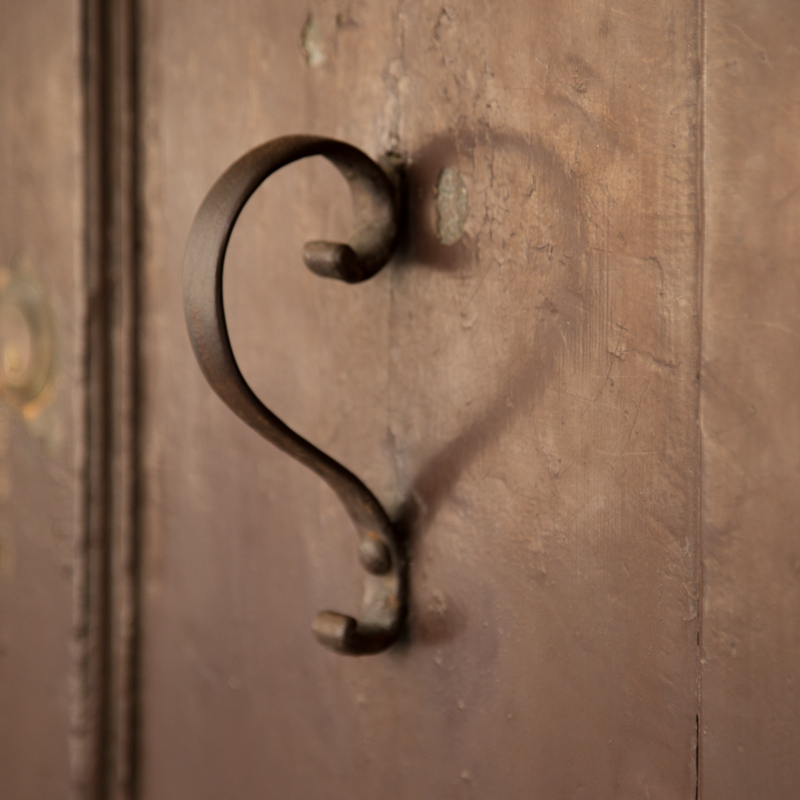 Loved ones that are gonecast a light that reminds us,love is forever.A door pull in Padua, Italy.