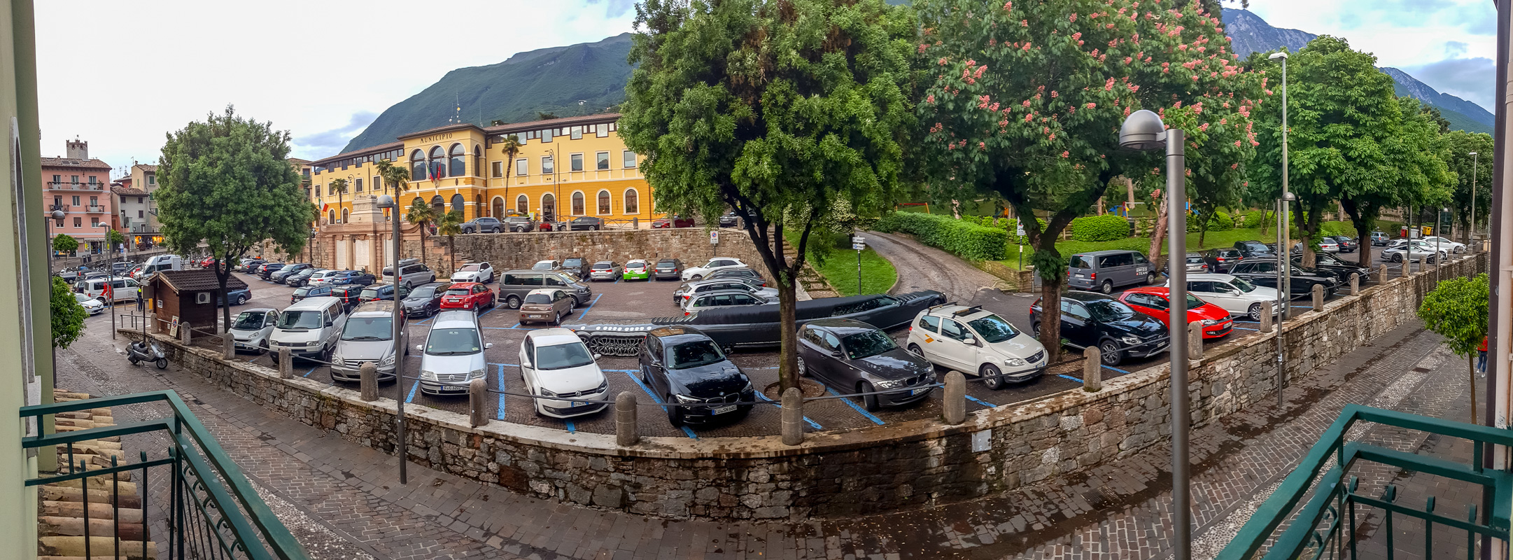 Panoramic view from our hotel room of the mountains and city hall.