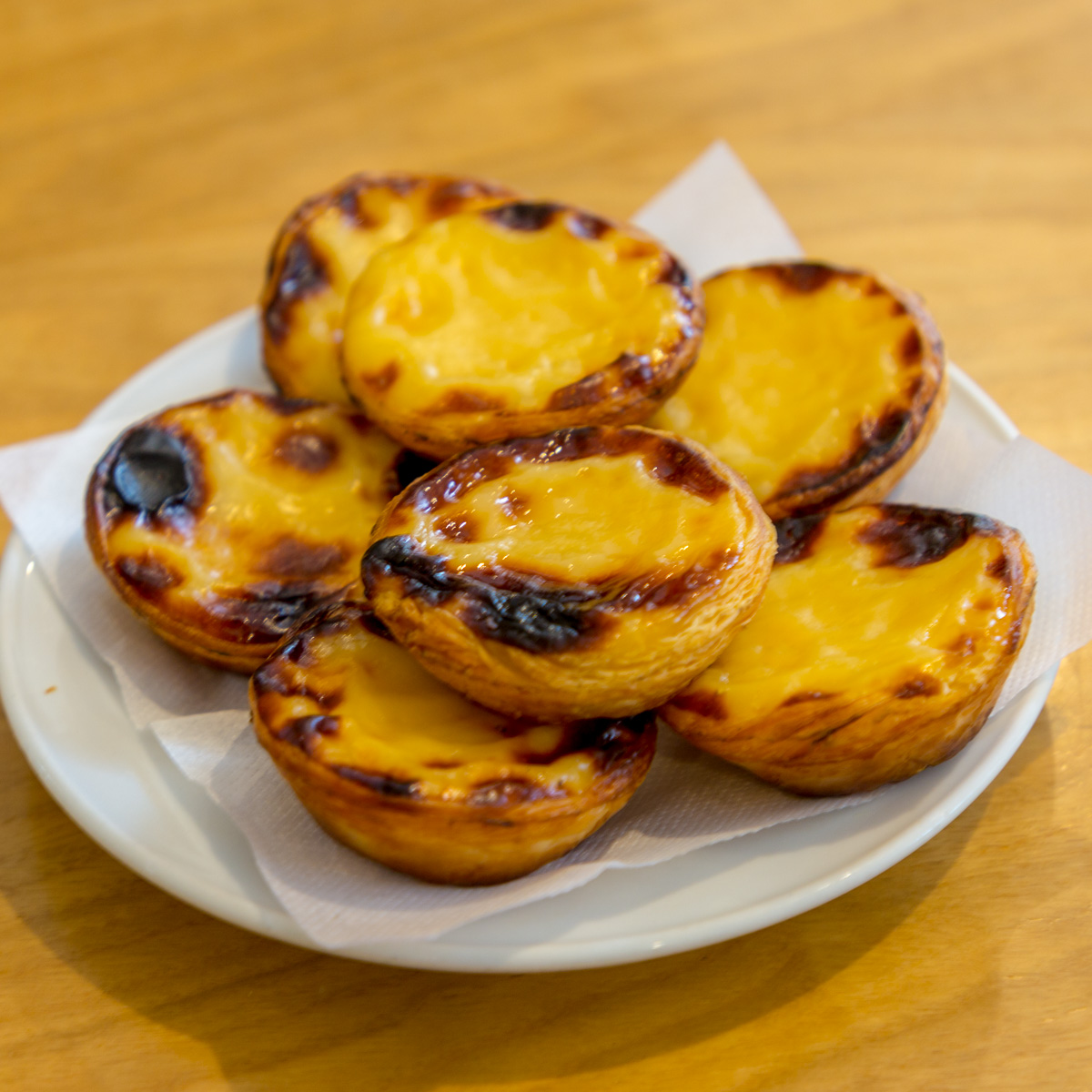 Pastéis de Nata, or Portuguese custard tart, is a Portuguese egg tart pastry dusted with cinnamon. Originally made by the Monastery of the Hieronymites it is a national treat enjoyed in former Portuguese colonies and in other countries with Portuguese populations. - WCF-7927.jpg