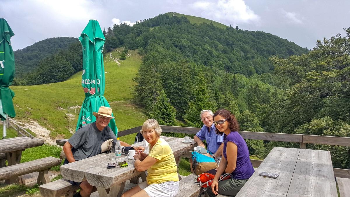 (L-R) Chris, Janet, Paul, and Zana taking lunch near Mount Blegoš (in the background) - WCF-144346.jpg