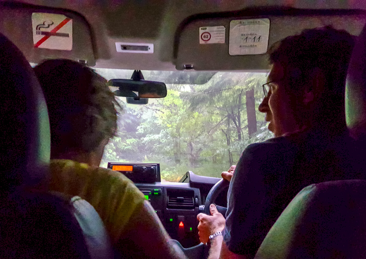 All together in the van with Luka backing down the narrow muddy road in the rain. - WCF-154441.jpg