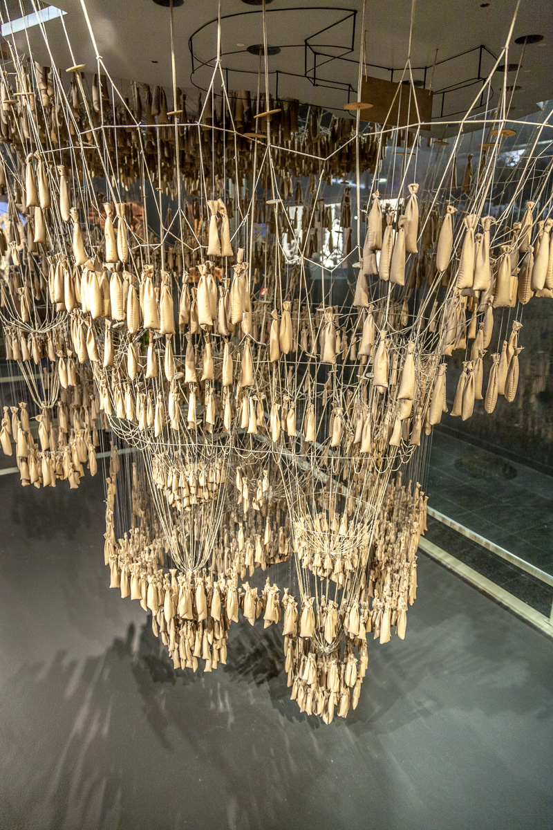 "Gaudi's ""hanging chain"" model made of weights on strings that would serve as an upside down version of the arched forms. -2370"