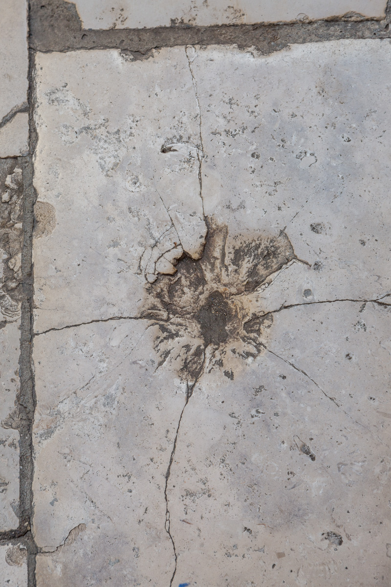 Grenade damage in street paver. - WCF-2666.jpg
