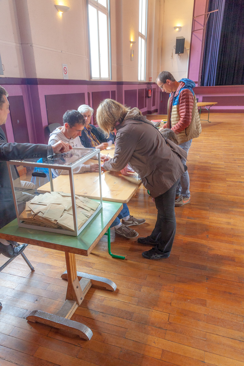 Lucie and Nicolas preparing to place their ballots in the transparent box in the foreground. - WCF-9934.jpg